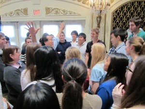 Yo-Yo Ma exhorts the Youth Orchestra musicians.