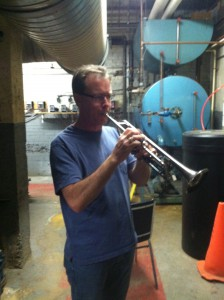Mike Walk warms up in the Powell Hall boiler room.