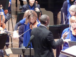 "Angie Smart warmed up for this week's performance of Vivaldi's ""Summer,"" from ""The Four Seasons,"" during recent Education Concerts."