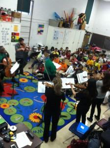 Berakiah Boone with members of the St. Louis Symphony strings at Dewey Elementary.