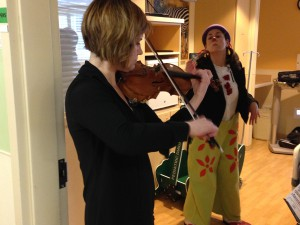 "Symphony first violinist Angie Smart and Claire ""The Clown"" Wedemeyer making their rounds at Mercy Children's Hospital."