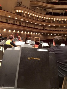 A horn-section view of Carnegie rehearsal.