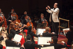 Charles Dutoit leads the NYO-USA at Carnegie Hall. Grant Riew, cellist, seated to the conductor's right.