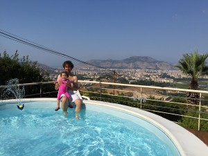 Carina and Shannon Wood enjoy a rooftop pool overlooking Palermo.