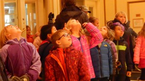 """Schoolchildren enter Powell Hall and provide the """"look up"""" photo op on a cold February morning."""