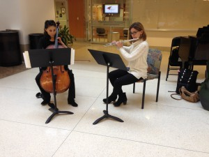 Monday afternoon, Feb. 22. The Symphony's Elizabeth Chung and Ann Choomack perform at the Siteman Cancer Center