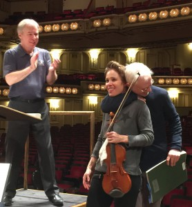 A hug following the Thursday rehearsal: David Robertson, Leila Josefowicz, John Adams
