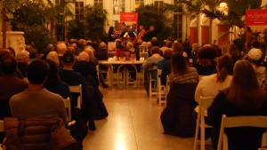Tuesday evening, Feb. 23, a Symphony In Your Neighborhood concert at Tower Grove Park. An SRO audience in Piper Palm House hears Jooyeon Kong, Eva Kozma, Morris Jacob and Anne Fagerburg perform.