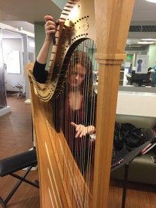 Allegra Lilly tunes at SLU Cancer Center's Blood & Marrow Outpatient Transplant facility.