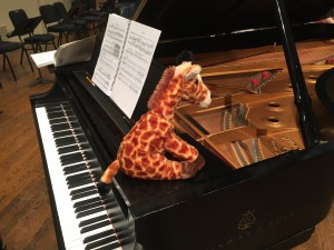 A toy giraffe taking up residence on the piano. I was told one of the vocalists held it during rehearsal, bringing comfort to Strauss' vocal challenges.