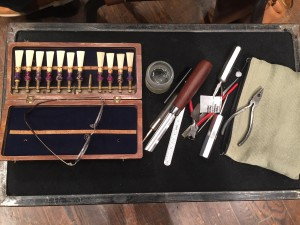 Bassoonist Felicia Foland's miniature double-reed repair shop on a small table next to her chair.